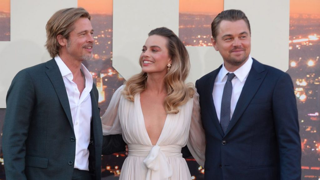 This is margot robbie with brad pit and leonardo dicaprio